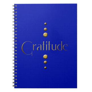 Gratitud del bloque del oro de 3 puntos y fondo az note book