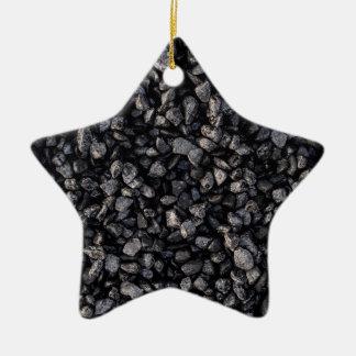 Grava del asfalto adorno de cerámica en forma de estrella