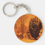Graveyard in the snow key chains