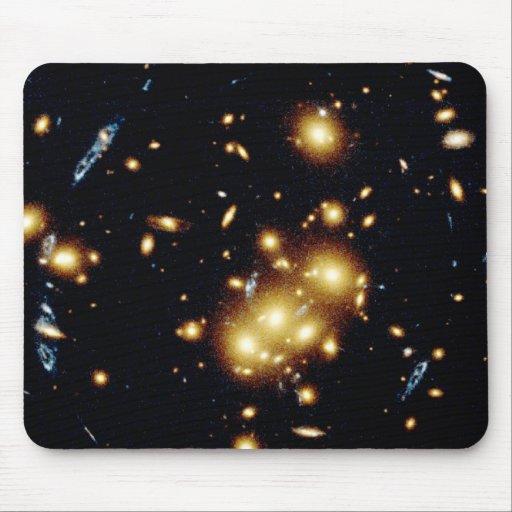 Gravitational Lens Captures Image of Primeval Gala Mouse Pads