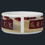 "Gravity Dog Bowl<br><div class=""desc"">Gravity written using tiles. Perfect for the science or physics geek! From wikipedia - Gravitation, or gravity, is a natural phenomenon by which physical bodies attract each other with a force proportional to their masses. Gravitation is most familiar as the agent that gives weight to objects with mass and causes...</div>"