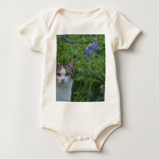 Gray and white cat in field of blue bonnets baby bodysuit
