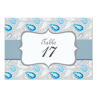 gray&blue paisley pattern on gray table number invitations