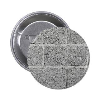 Gray brick wall background 2 inch round button