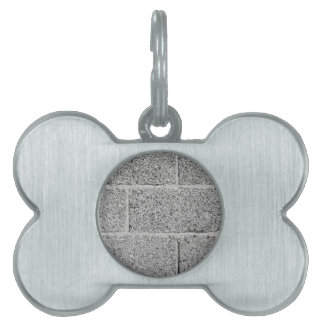 Gray brick wall background pet tags
