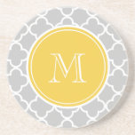 "Gray Quatrefoil Pattern, Yellow Monogram Coaster<br><div class=""desc"">Trendy, stylish, grey or gray and white quatrefoil pattern you can personalize with a white monogram initial in a modern font, on a yellow circle label, banner, frame with white circular lines border. GraphicsByMimi&#169; A trendy pattern for her. Use the template field to add your monogram initial or letter or...</div>"