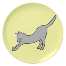 Gray Stretching Cat on Yellow Plate
