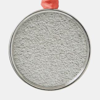 Gray wall closeup uneven granular cement coating metal ornament