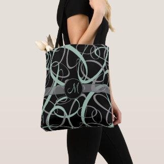 Grayed jade and gray loops on black retro monogram tote bag
