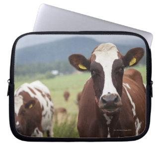 Grazing cows laptop sleeve