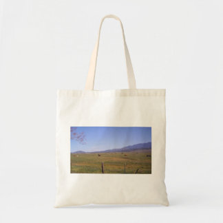 Grazing in the grass tote bag