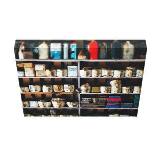 Greasy, oily containers on a shelf canvas print