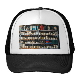 Greasy, oily containers on a shelf trucker hat
