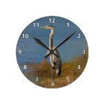 Great Blue Heron Bird at the Pond Round Wall Clocks