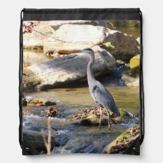 Great Blue Heron standing in creek photo Drawstring Backpacks