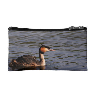 Great crested grebe with chick on back makeup bag