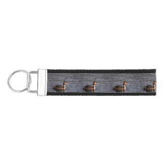 Great crested grebe with chick on back wrist keychain