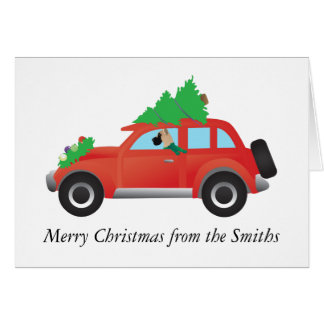 Great Dane driving car with Christmas tree on top Card
