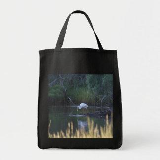 Great Egret Eating Bag