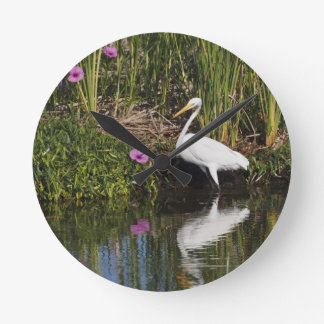 Great Egret hunting fish in freshwater marsh Round Clock