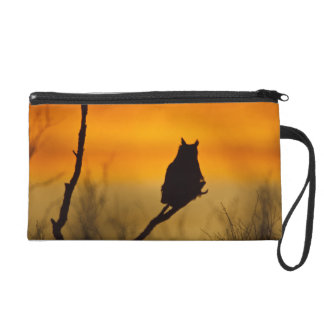 Great Horned Owl perched at sunset Wristlet