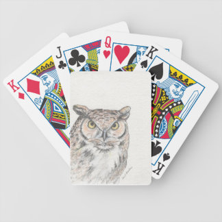Great horned owl playing cards