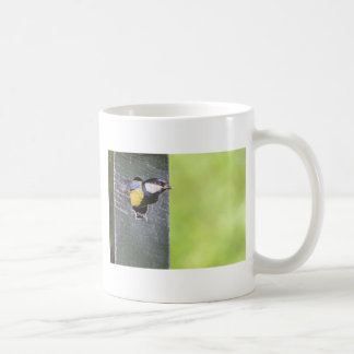 Great tit parent in hole of nest box coffee mug