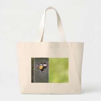 Great tit parent in hole of nest box large tote bag