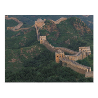 Great Wall winding through mountains. Postcard