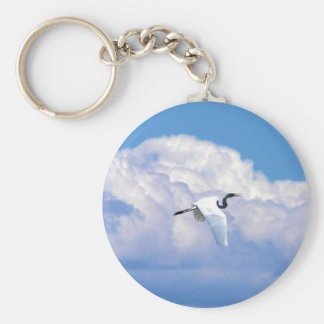 Great white egret flying in the beautiful sky keychains