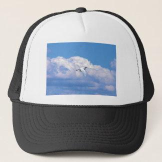 Great white egret flying in the beautiful sky trucker hat