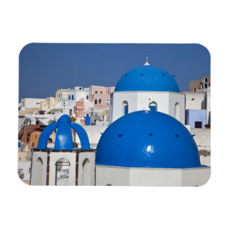 Greece, Santorini. Bell tower and blue domes of Magnet