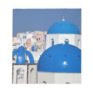 Greece, Santorini. Bell tower and blue domes of Notepad