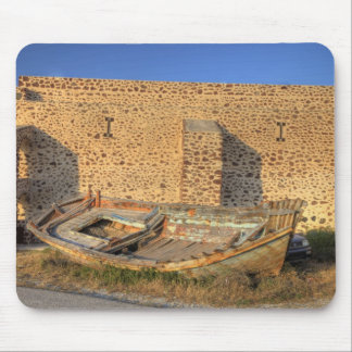 Greece, Santorini, Oia. Old fishing boat on dry Mouse Pad