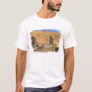 Greece, Santorini, Oia. Old fishing boat on dry T-Shirt
