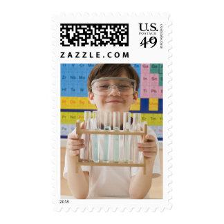 Greek boy holding rack of test tubes postage