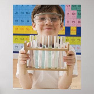 Greek boy holding rack of test tubes posters