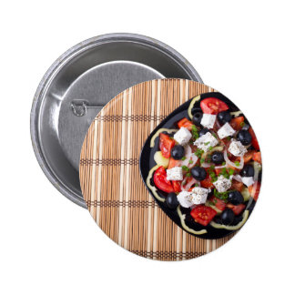 Greek vegetarian salad of tomatoes, cucumbers, oni button