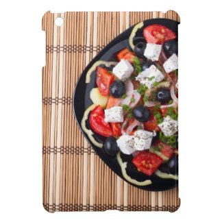 Greek vegetarian salad of tomatoes, cucumbers, oni iPad mini covers