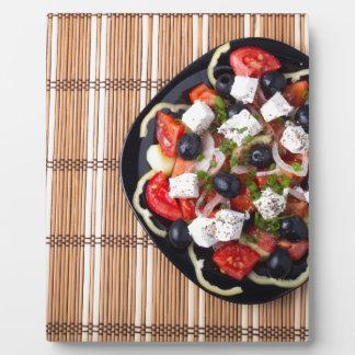 Greek vegetarian salad of tomatoes, cucumbers, oni plaque