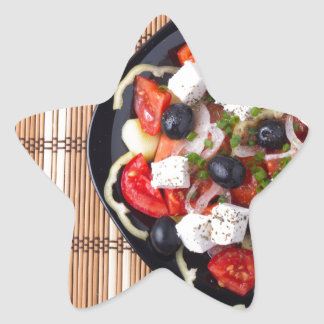 Greek vegetarian salad of tomatoes, cucumbers, oni star sticker