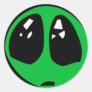 green alian big eyes. classic round sticker
