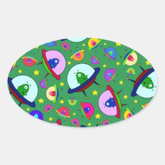 Green alien spaceship pattern oval sticker