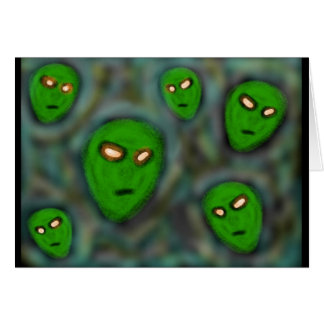 green aliens with glowing eyes murky background card
