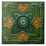 """Green &amp; Amber Victorian Design Majolica Tile<br><div class=""""desc"""">Majolica tiles were valued for their rich colors and intricate designs. They have been produced for hundreds of years and often featured dimensional designs. Our reproduction is flat but captures the beauty and sculptural quality of the original.</div>"""