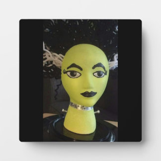 "Green And Black Bizarre ""Green Goddess"" Manequin Plaque"