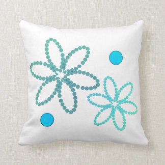 Green and blue flowery pillow