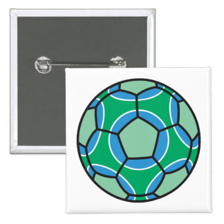 green and blue soccerball pins