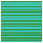 [ Thumbnail: Green and Dark Turquoise Pattern Fabric ]