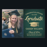 """Green and Gold Graduate Photo Graduation Picture Lawn Sign<br><div class=""""desc"""">Add a personalized touch to college or high school graduation party decorations with this custom photo green and gold lawn sign. Simply place in yard to welcome guests. Design features a faux gold foil mortar board, stylish modern typography, handwritten style script calligraphy, and a picture of the graduate, such as...</div>"""